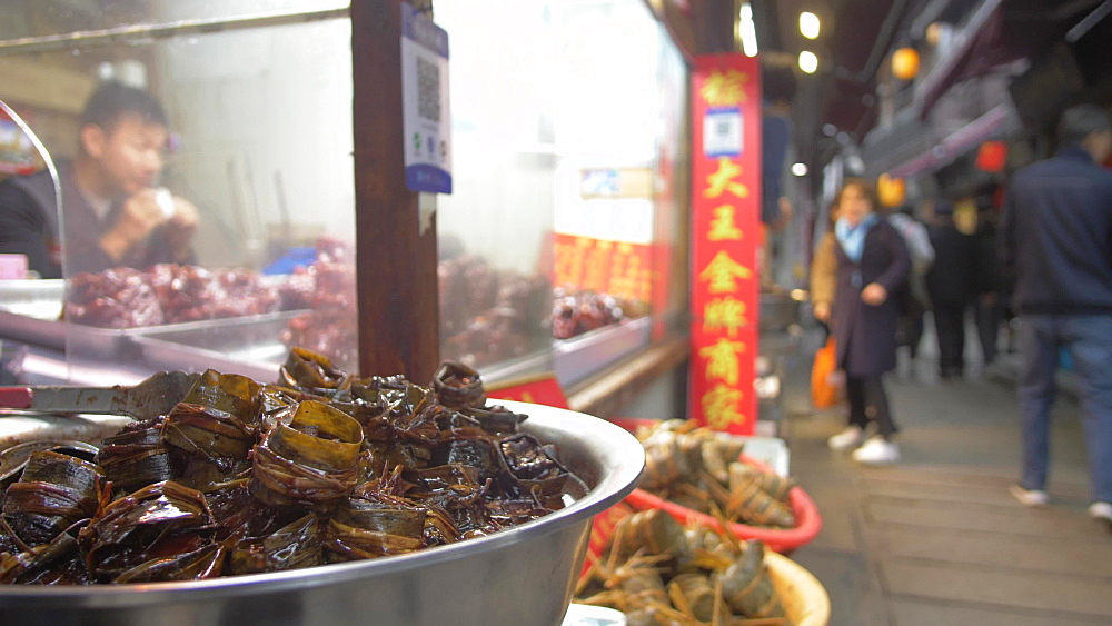 Produce for sale and visitors in Zhujiajiaozhen water town, Qingpu District, Shanghai, People's Republic of China, Asia