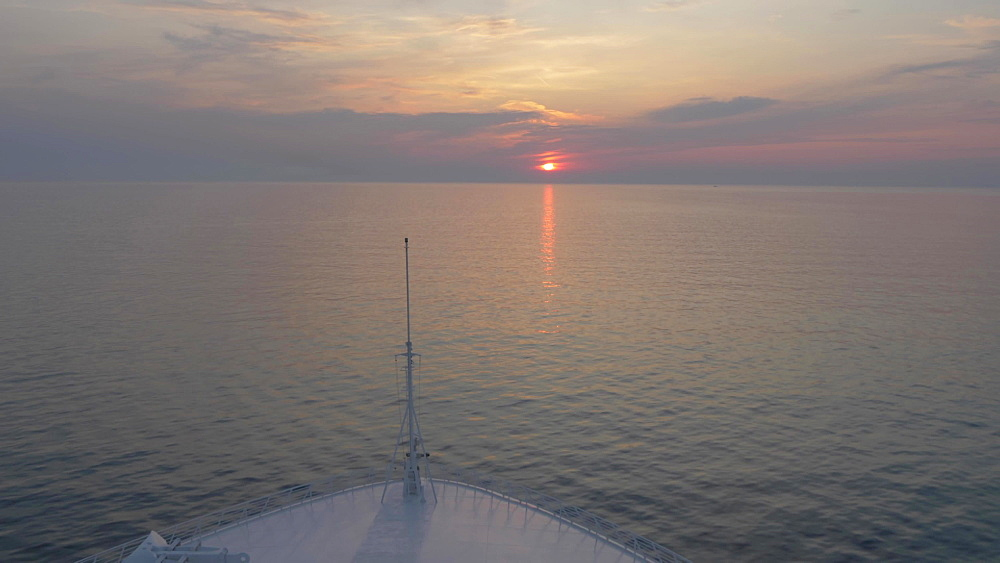 Sun setting on the Adriatic Sea viewed from cruise ship, Split, Dalmatian Coast, Croatia, Europe