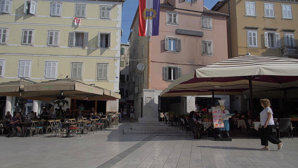 Pan shot of bars and cafes in People's Square or Pjaca, Split, Dalmatian Coast, Croatia, Europe