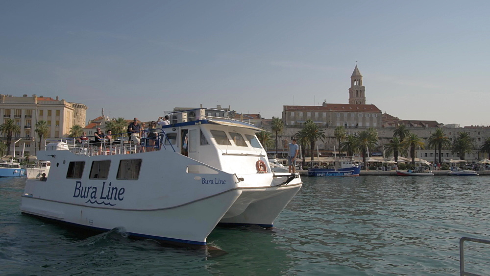 Boat arriving in Split Harbour and Cathedral of Saint Domnius, Split, Dalmatian Coast, Croatia, Europe