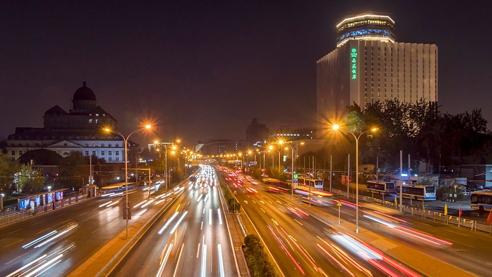 Time lapse of traffic trail lights on major road near Beijing Zoo at dusk, Beijing, People's Republic of China, Asia