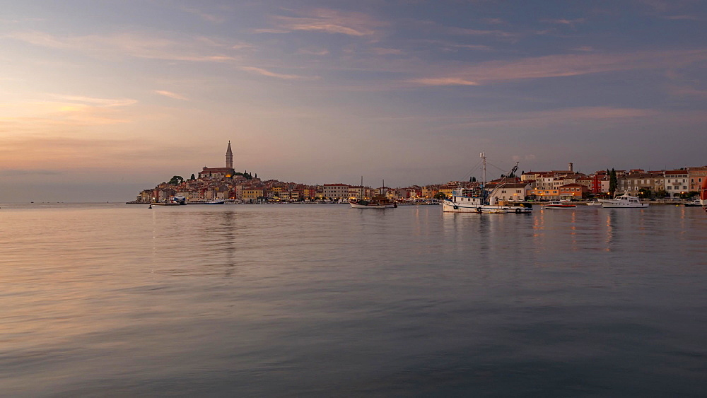 Time lapse of lighting up time of old town with the Cathedral of St. Euphemia from harbour, Rovinj, Istria, Croatia, Adriatic, Europe