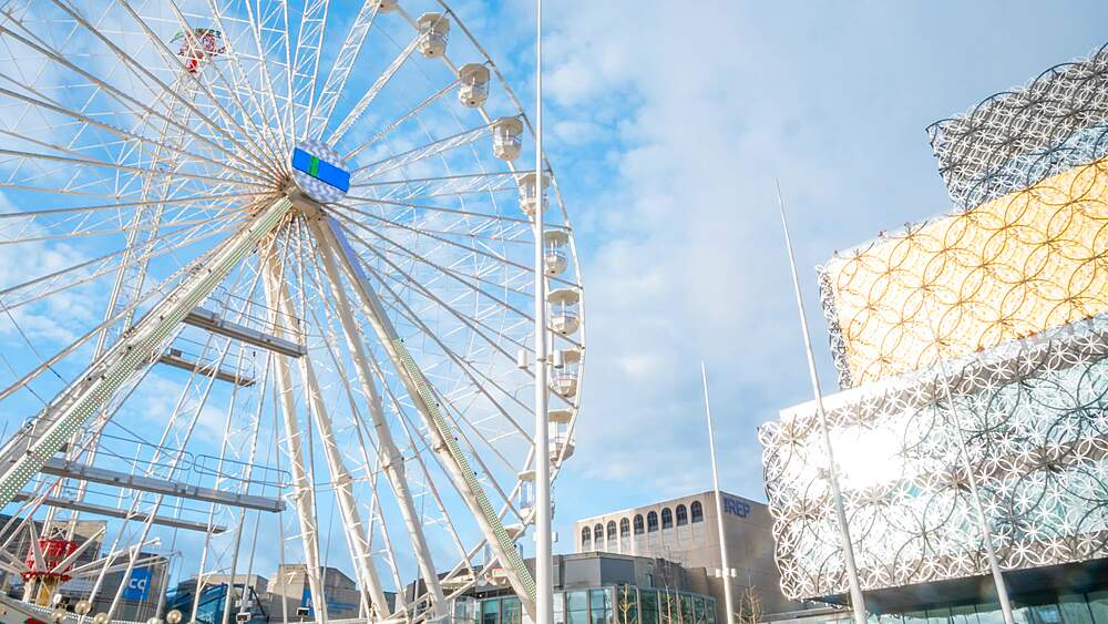 Time lapse of ferris wheel and Public Library, Birmingham, England, United Kingdom, Europe