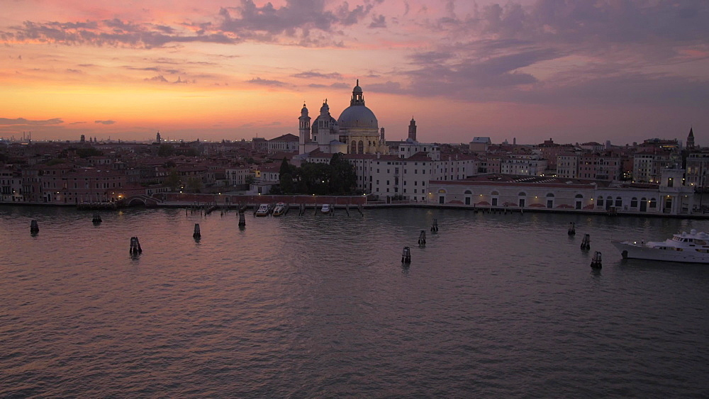 Basilica di Santa Maria della Salute, Doge's Palace and Campanile from cruise ship at dusk, Venice, UNESCO World Heritage Site, Veneto, Italy, Europe