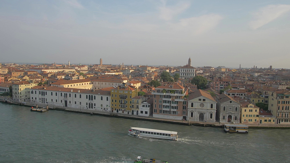 View of boats, Basilica di Santa Maria della Salute and Venice from cruise ship, Venice, UNESCO World Heritage Site, Veneto, Italy, Europe