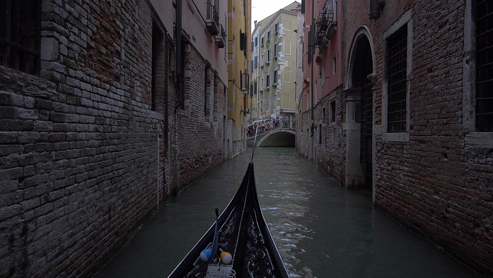 Shot from onboard a gondola on canal, Venice, UNESCO World Heritage Site, Veneto, Italy, Europe