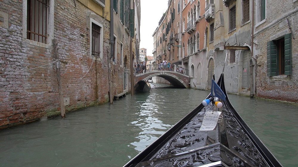 Shot from onboard a gondola on canals, Venice, UNESCO World Heritage Site, Veneto, Italy, Europe