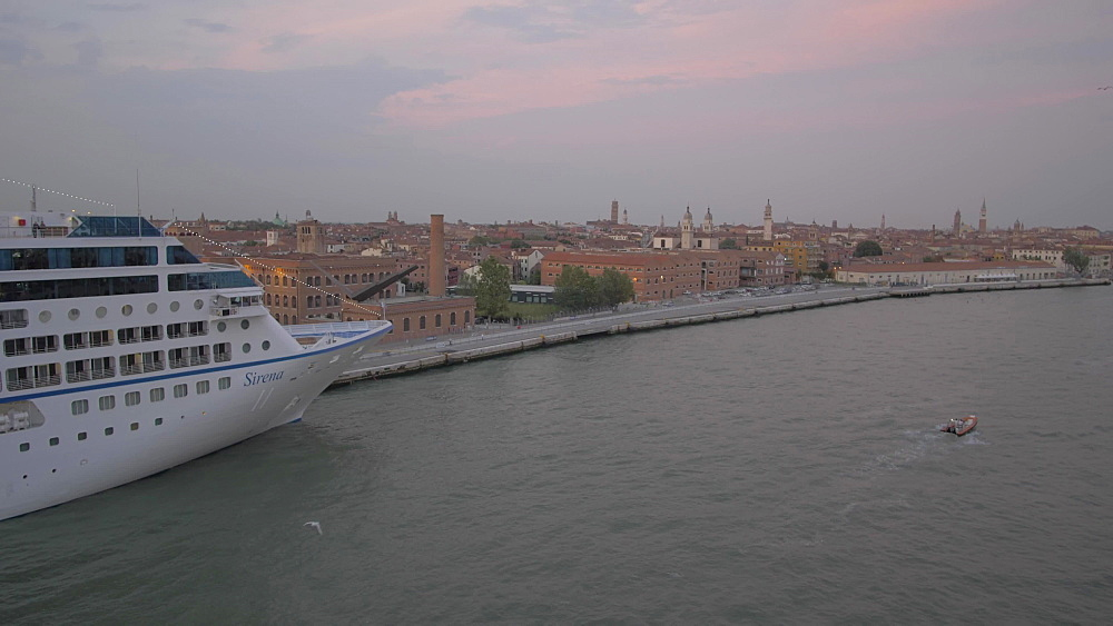 Boats and Venice near cruise ship terminal from cruise ship at dusk, Venice, UNESCO World Heritage Site, Veneto, Italy, Europe
