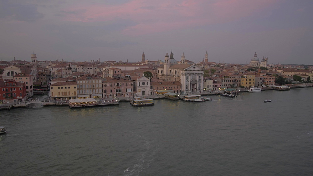 View of Church of Santa Maria del Rosario from cruise ship at dusk, Venice, UNESCO World Heritage Site, Veneto, Italy, Europe