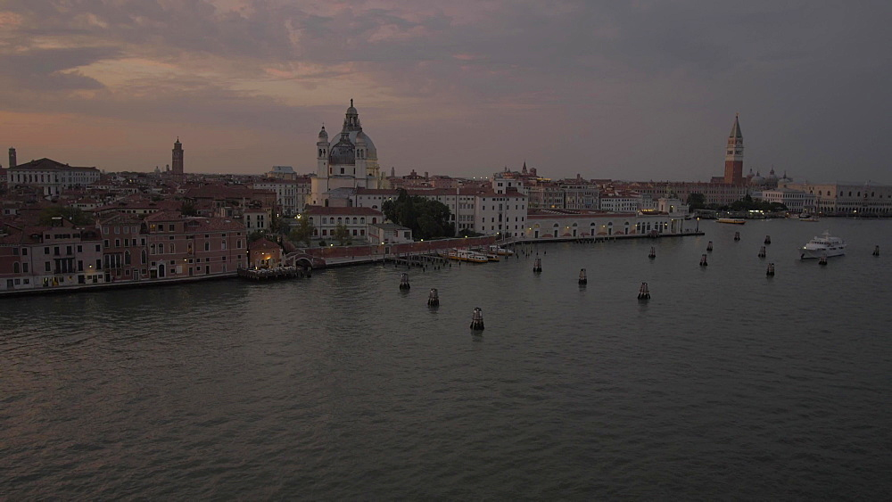 View of Basilica di Santa Maria della Salute and Venice from cruise ship at dusk, Venice, UNESCO World Heritage Site, Veneto, Italy, Europe