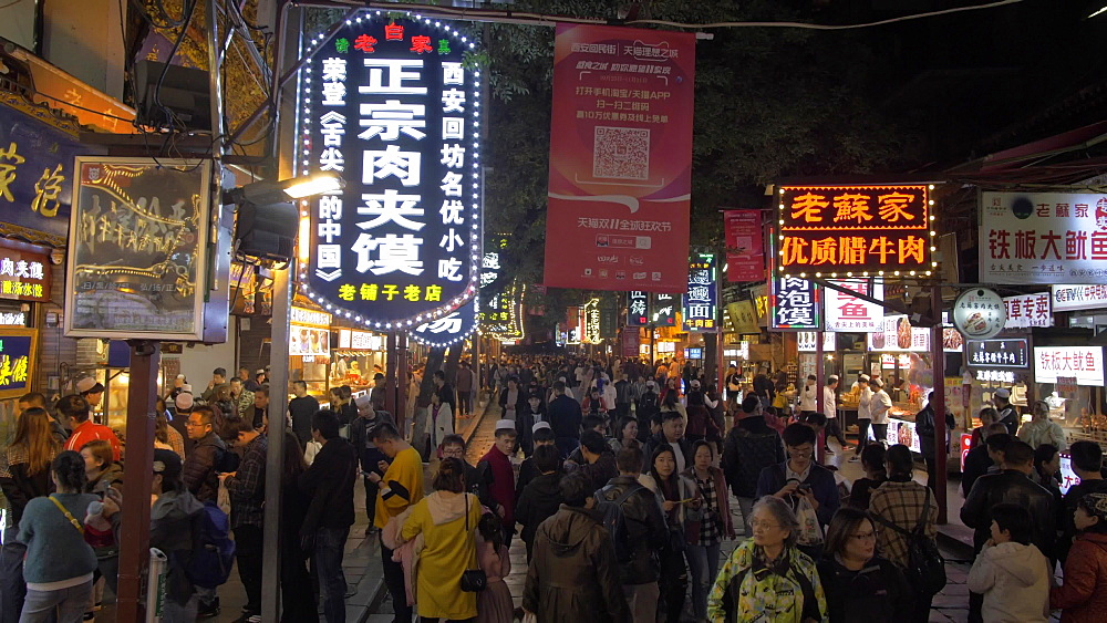 Tracking shot of night market stalls in Xi?an, Xi'an, Shaanxi Province, People's Republic of China, Asia
