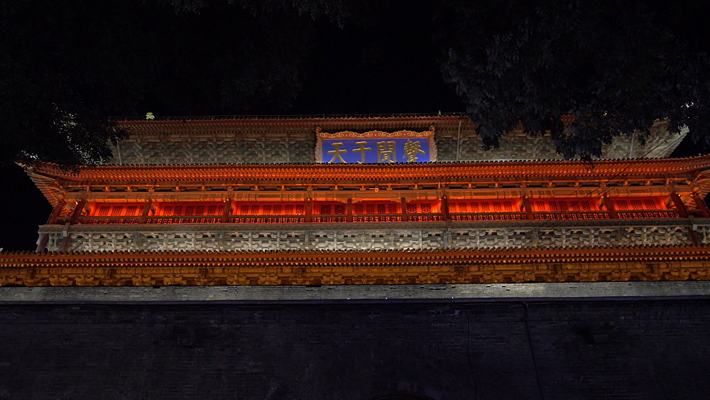 Tracking shot of ornate City Wall near Huan Cheng Gong Park at night, Xi'an, Shaanxi, People?s Republic of China, Asia