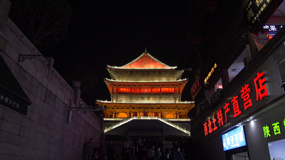 Shops and ornate Bell Tower at night, Xi'an, Shaanxi, People's Republic of China, Asia
