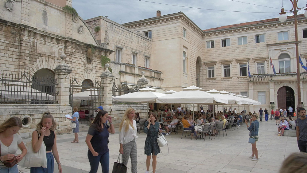 Pan shot from street sign to busy People?s Square, Zadar, Zadar County, Dalmatia region, Croatia, Europe