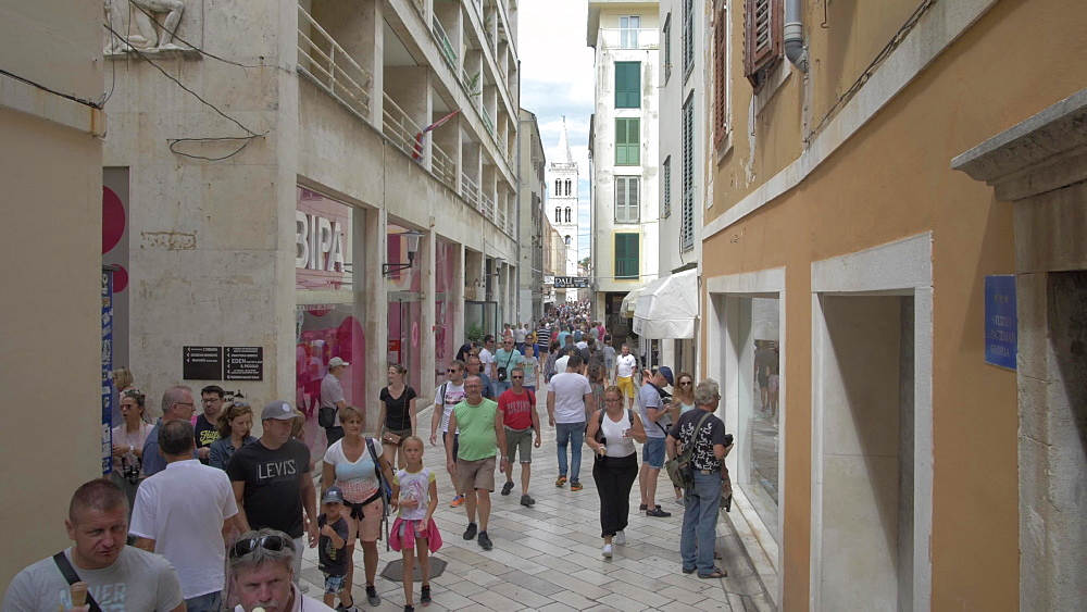 Crane shot from souvenirs to busy narrow street, Zadar, Zadar County, Dalmatia region, Croatia, Europe