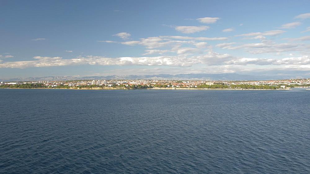 Pan shot of Zadar from cruise ship in the Adriatic Sea, Zadar, Zadar County, Dalmatia region, Croatia, Europe