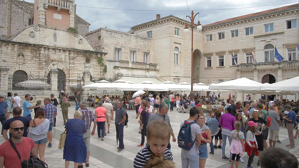 Crane shot from street sign to busy People?s Square, Zadar, Zadar County, Dalmatia region, Croatia, Europe