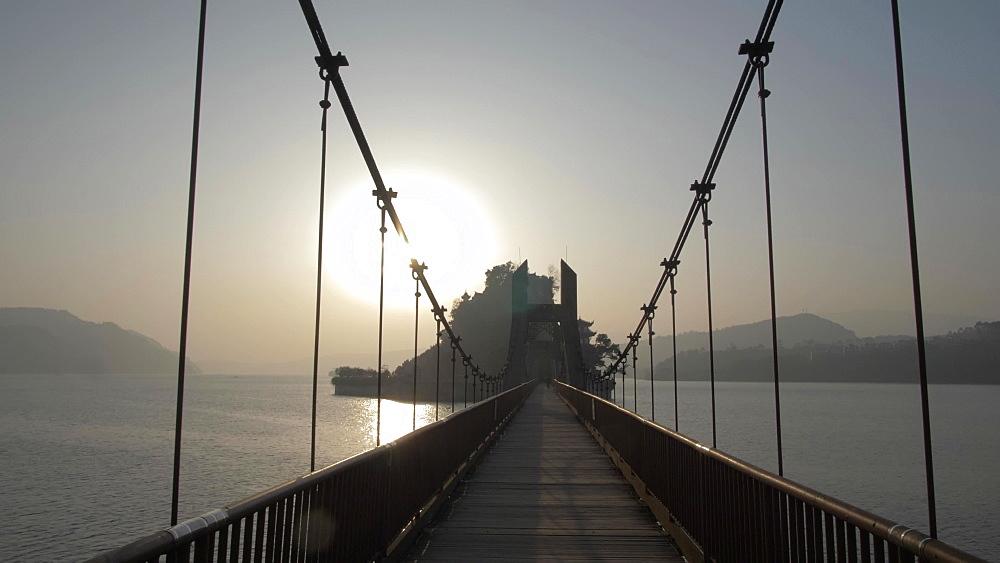 Bridge to Shi Baozhai Pagoda at sunset on Yangtze River near Wanzhou, Chongqing, People's Republic of China, Asia
