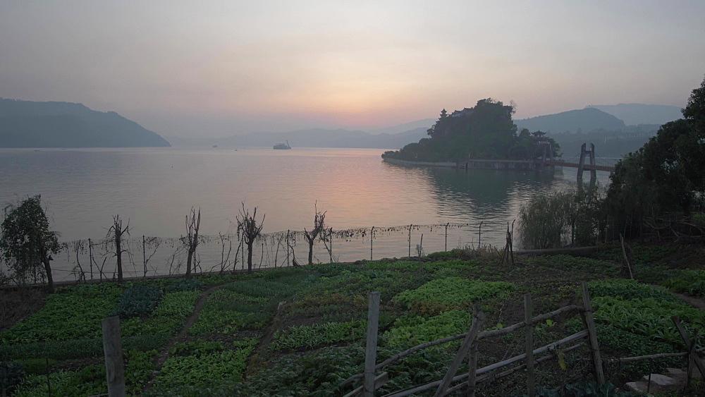 Yangtze River and Shi Baozhai Pagoda at sunset near Wanzhou, Chongqing, People's Republic of China, Asia