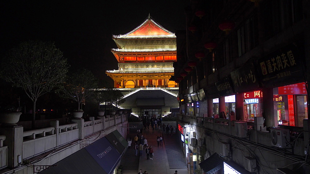Tilt shot of shopping street and ornate Bell Tower at night, Lianhu, Xi'an, Shaanxi, People?s Republic of China, Asia
