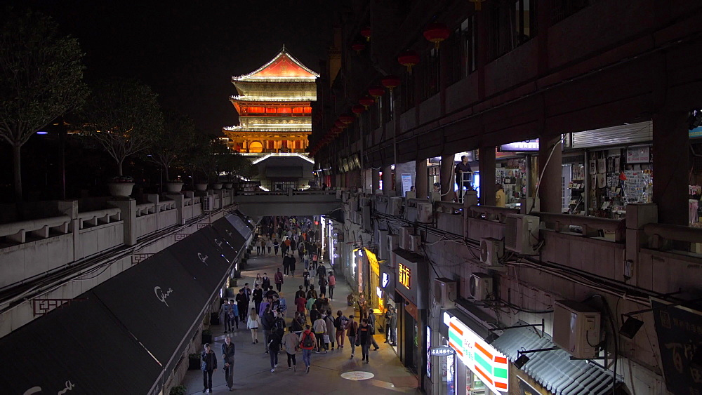 Shopping street and ornate Bell Tower at night, Lianhu, Xi'an, Shaanxi, People's Republic of China, Asia