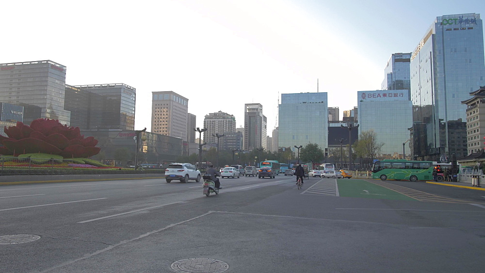 Pan shot of traffic and city near Huan Cheng Gong Park, Xi'an, Shaanxi, People?s Republic of China, Asia