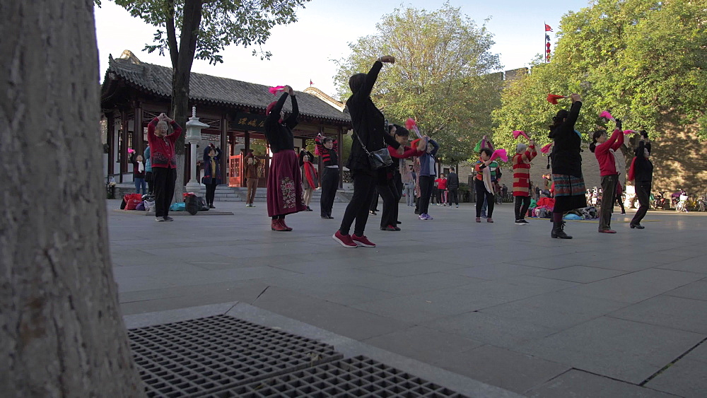 Slider shot of traditional Chinese excise and dance near City Wall, Xi'an, Shaanxi, People?s Republic of China, Asia
