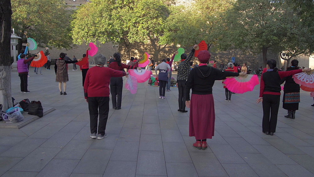 Tracking shot of traditional Chinese excise and dance near City Wall, Xi'an, Shaanxi, People?s Republic of China, Asia