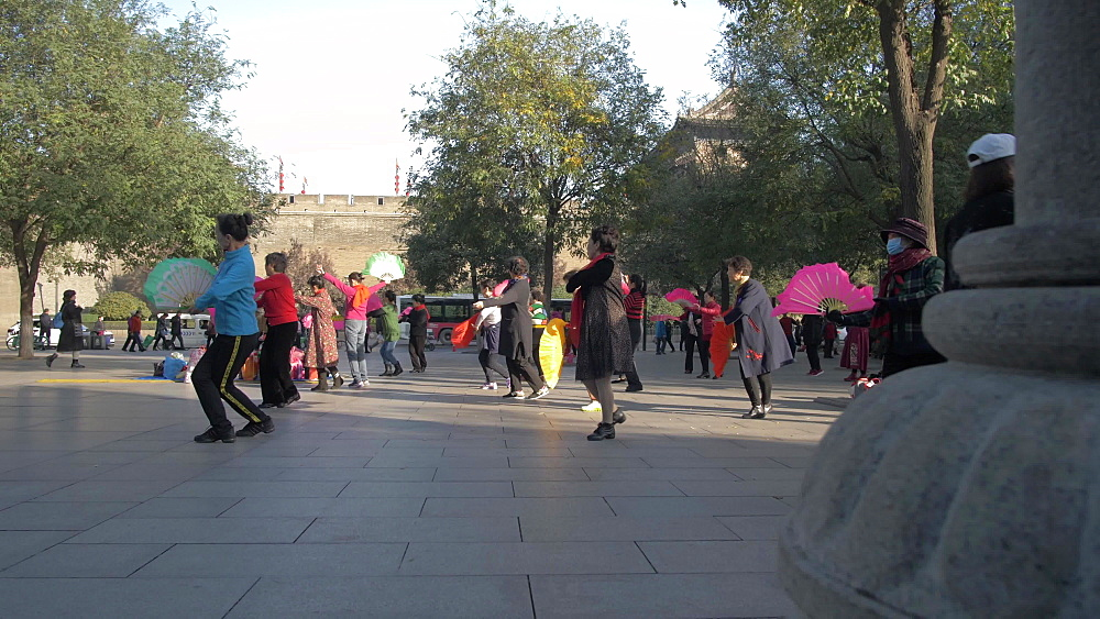 Traditional Chinese exercise and dance near City Wall, Xi'an, Shaanxi, People's Republic of China, Asia