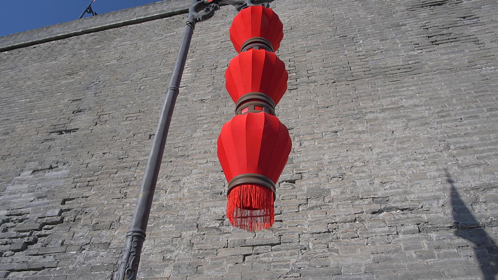 Tracking shot of traditional red lanterns and City Wall, Xi'an, Shaanxi, People?s Republic of China, Asia