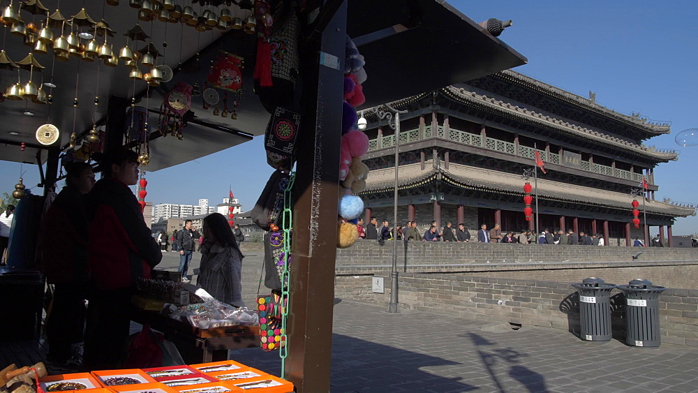Souvenir stall and traditional Chinese architecture of the City Wall, Xi'an, Shaanxi, People's Republic of China, Asia