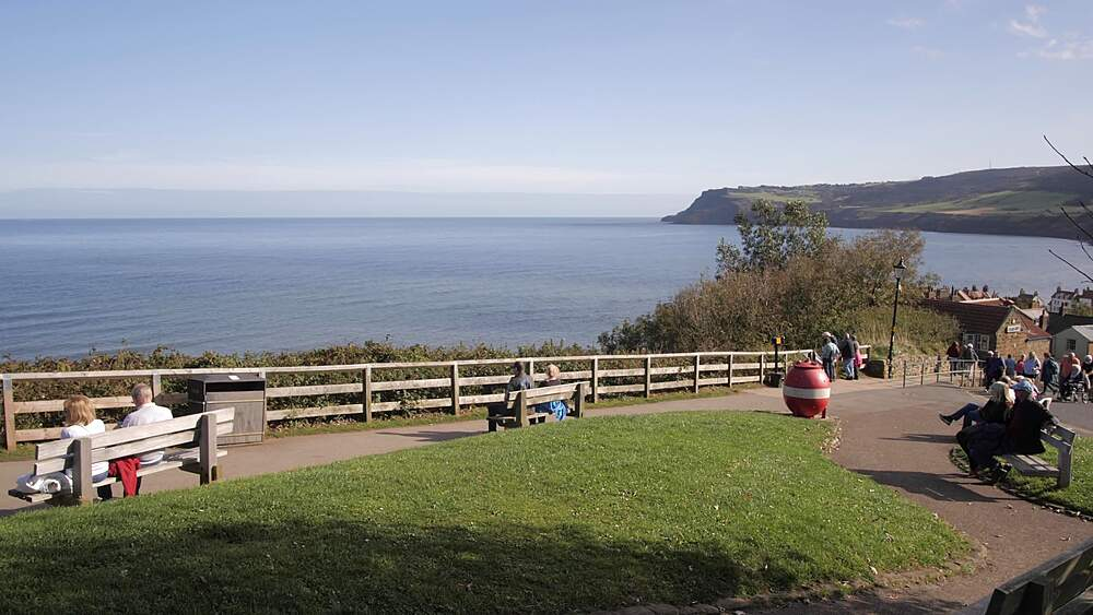 Visitors and bay in background, Robin Hood's Bay, North Yorkshire, England, United Kingdom, Europe