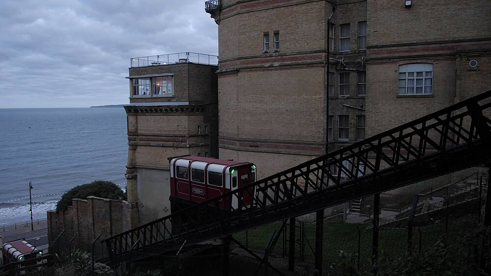 Beach tram in operation at dusk, Scarborough, North Yorkshire, Yorkshire, England, United Kingdom, Europe