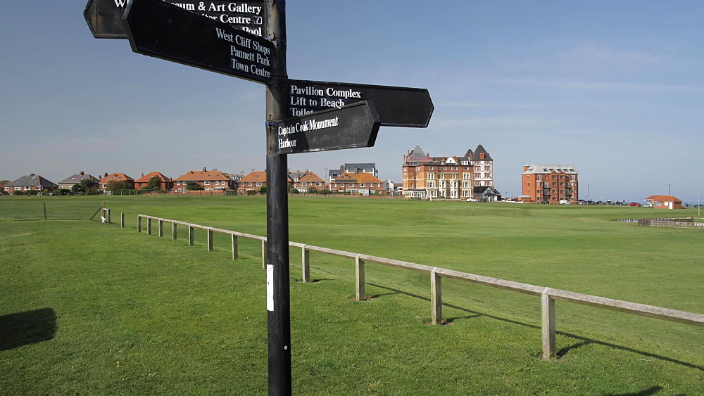Hotels and signpost at West Cliff, Whitby, North Yorkshire, England, United Kingdom, Europe