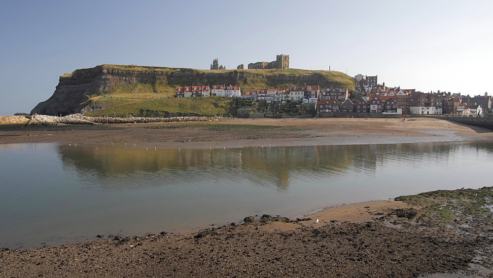 Shot through railings of River Esk and St. Mary's Church, Whitby, North Yorkshire, England, United Kingdom, Europe