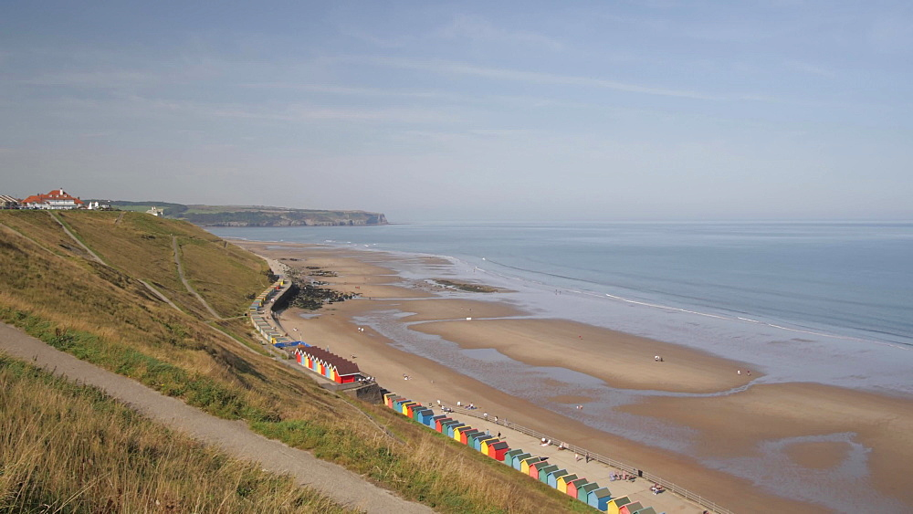 Hotels, Whitby Beach and colourful beach huts from West Cliff, Whitby, North Yorkshire, England, United Kingdom, Europe