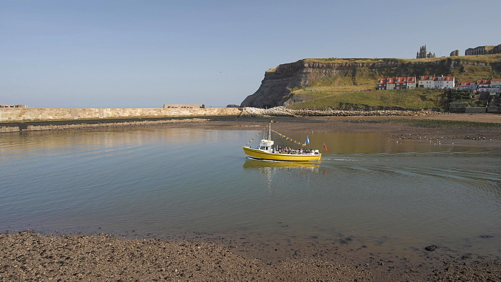 Tour boat on River Esk and St. Mary's Church, Whitby, North Yorkshire, England, United Kingdom, Europe