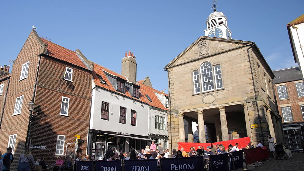 Buildings and cafe in Market Place, Whitby, North Yorkshire, England, United Kingdom, Europe
