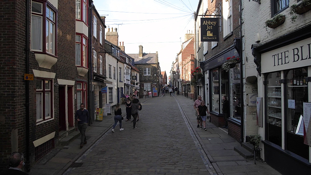 Buildings and shops on cobbled shopping street, Whitby, North Yorkshire, England, United Kingdom, Europe