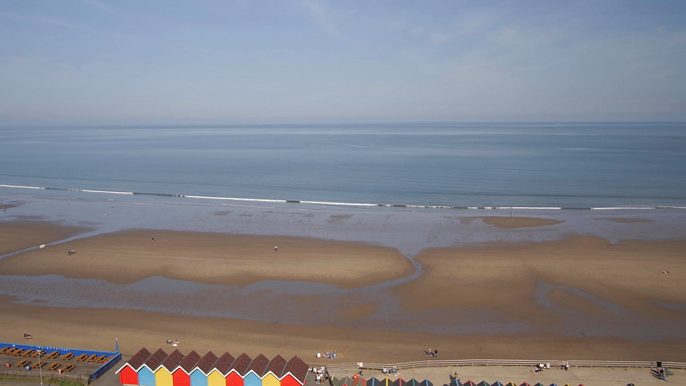 Whitby Beach and colourful beach huts from West Cliff, Whitby, North Yorkshire, England, United Kingdom, Europe