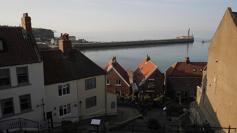 Buildings overlooking harbour and sea, Whitby, North Yorkshire, England, United Kingdom, Europe