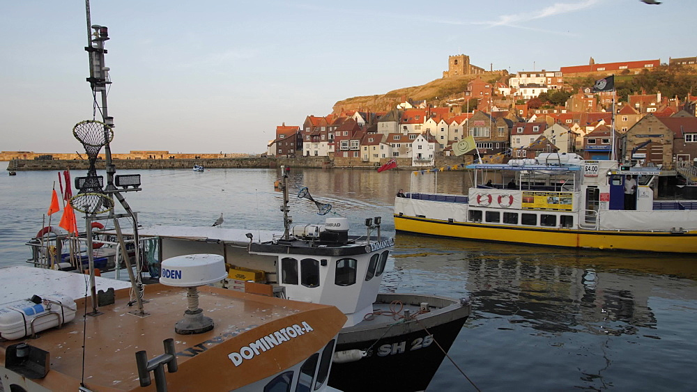 Boat on River Esk and St. Mary's Church, Whitby, North Yorkshire, England, United Kingdom, Europe