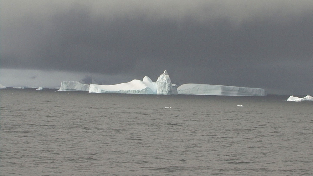 statue looking ice berg, Drakes Passage, Antarctic peninsula - 958-799