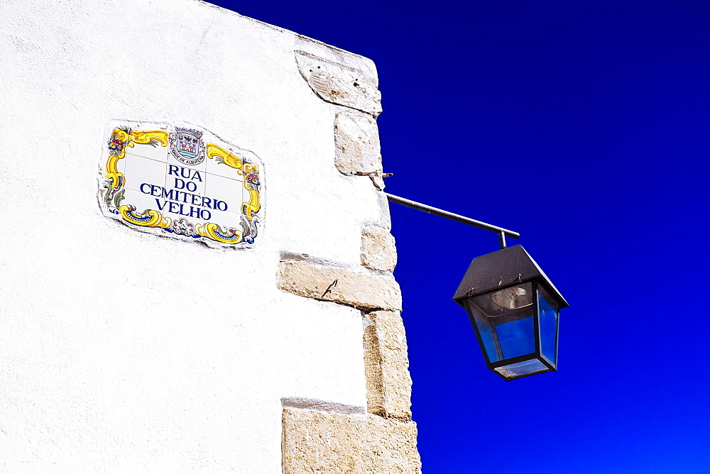 Traditional local street sign and street lamp, Old Town, Albufeira, Algarve, Portugal, Europe - 10-414