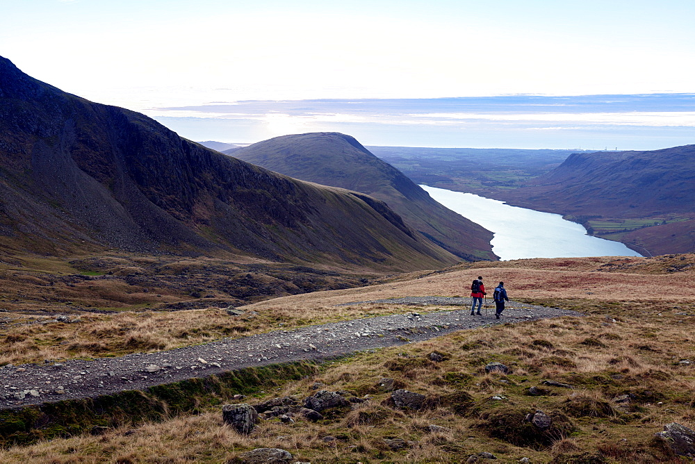Two men descend from Scafell Pike towards Wast Water, Lake District, Cumbria, England, United Kingdom, Europe - 10-450