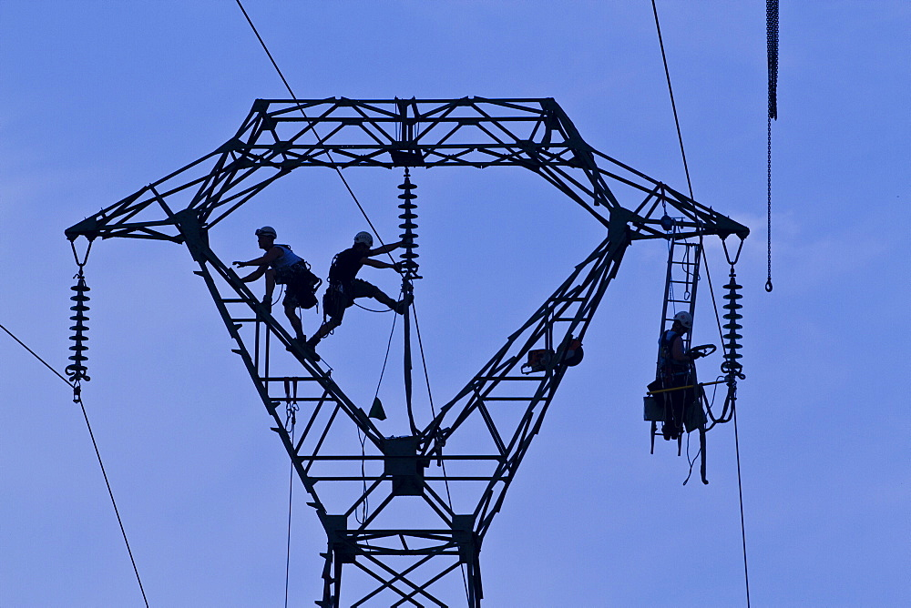 Workers on pylon, Brittany, France, Europe  - 1061-31