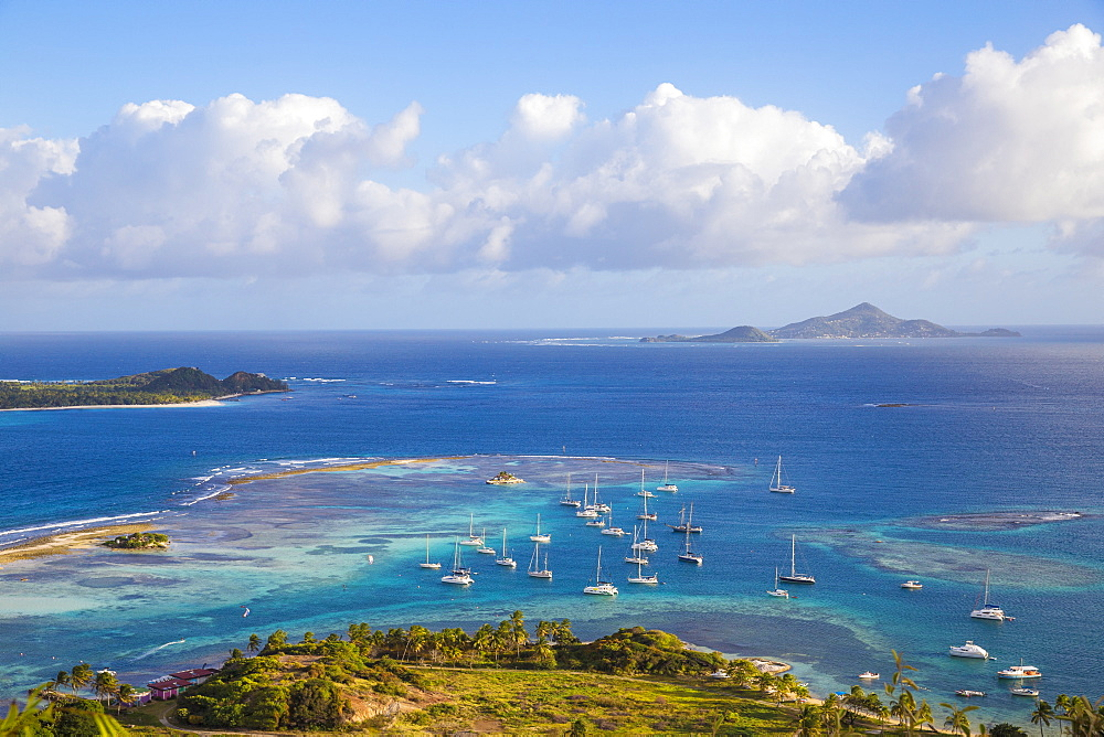 View towards Palm Island with Petit St. Vincent and Carriacou in distance, Union Island, The Grenadines, St. Vincent and The Grenadines, West Indies, Caribbean, Central America