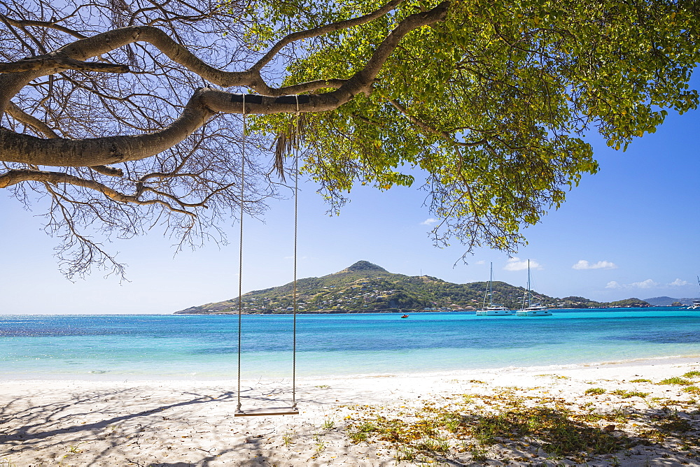 Looking across to Carriacou, Grenada, Petit St. Vincent, The Grenadines, St. Vincent and The Grenadines, West Indies, Caribbean, Central America