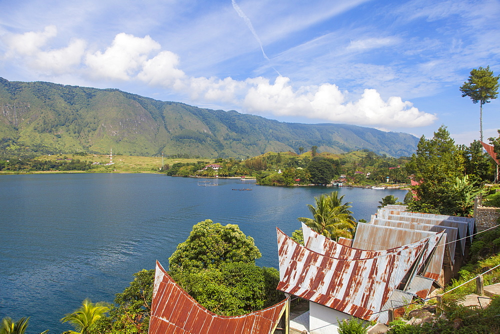 Typical Batak houses overlooking Lake Toba, Tuk Tuk, Lake Toba, Samosir Island, Sumatra, Indonesia, Southeast Asia, Asia
