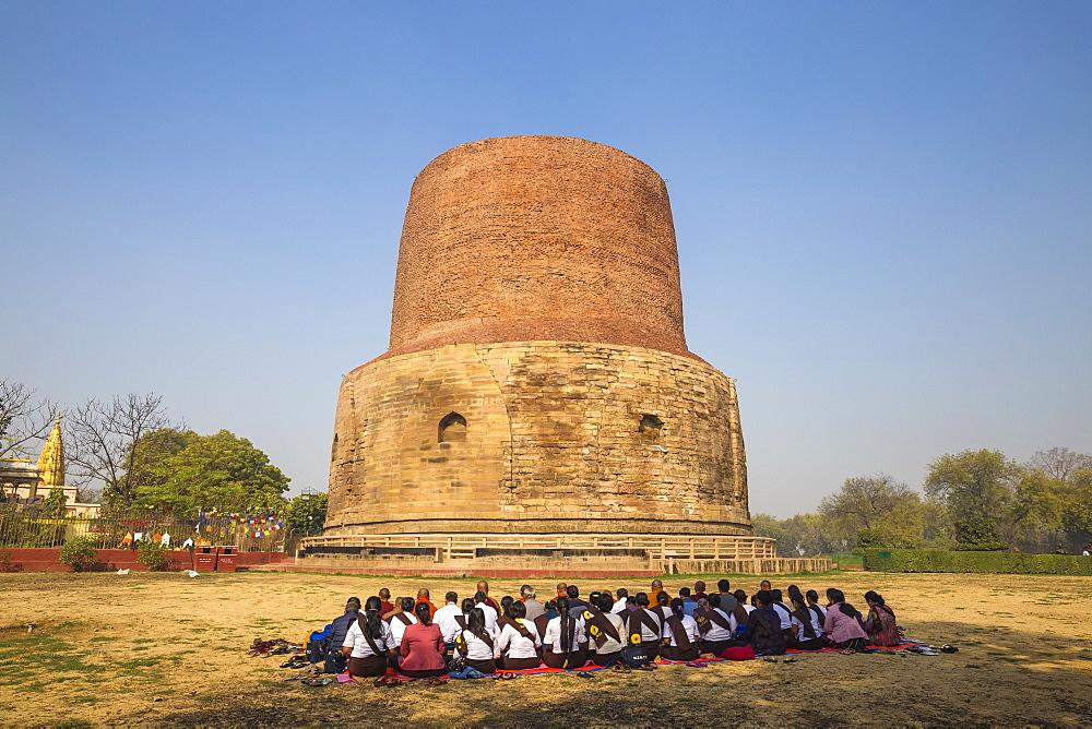 India, Uttar Pradesh, Sarnarth, Pilgrims infront of the Dhamekh Stupa